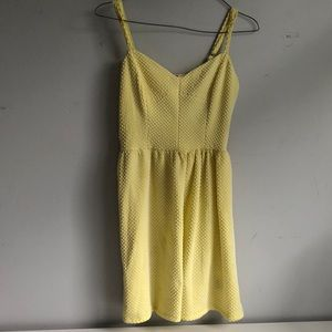 Yellow dress with white wolka dots